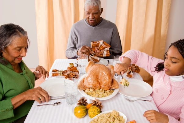 Family around table for Thanksgiving dinner