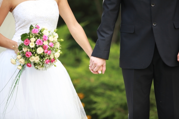 Canva - Wedding couple arm in arm (4)